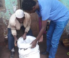 Our Project Manager, Michael, showing a farmer in Jimma, Gomma Woreda, how to use a PICS Bag.